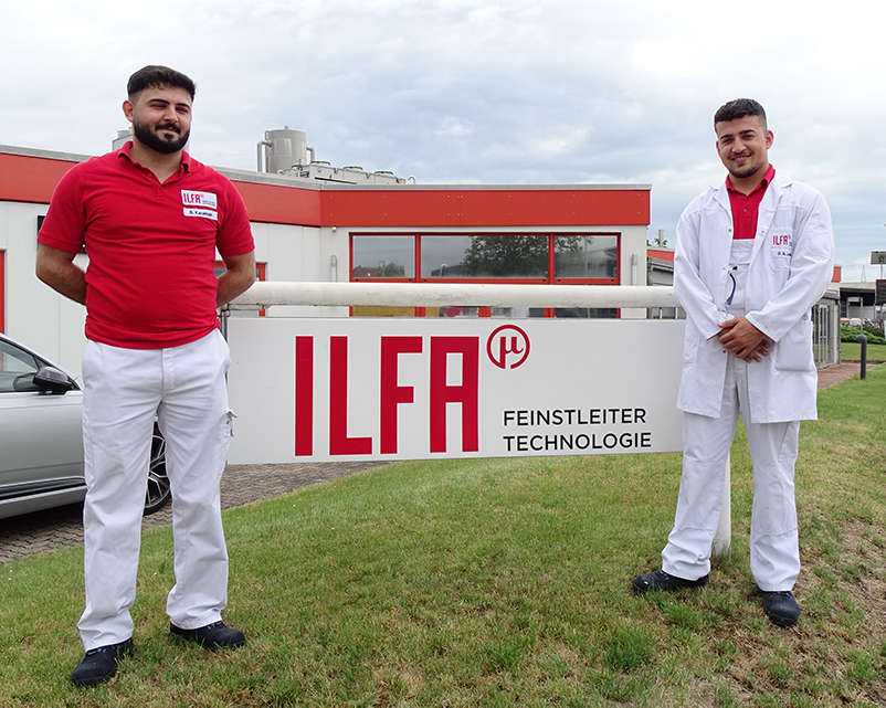 two young men finished apprenticeship at ILFA